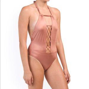 One piece lace up bathing suit